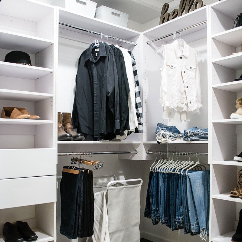 Men's closet system with drawers, shelves, and hanging space
