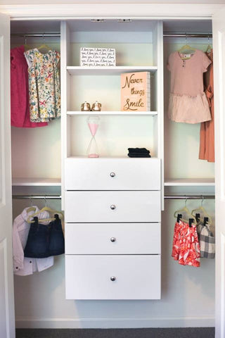 Kids' custom closet system with shelves, drawers, and hanging rods