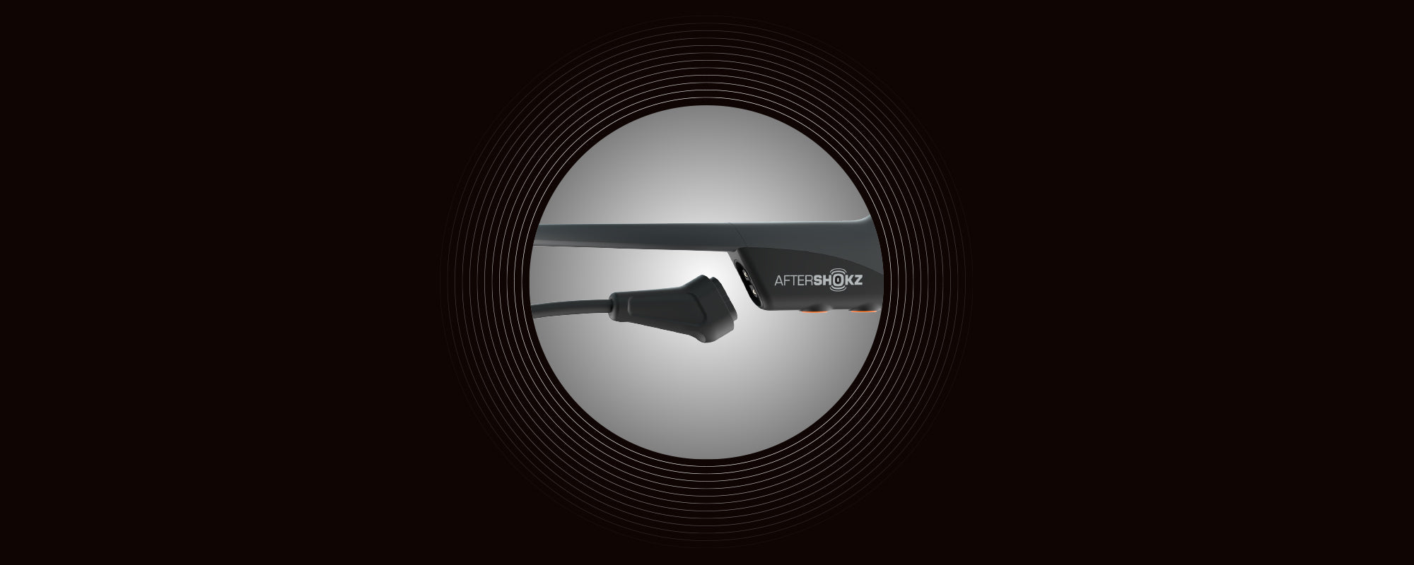 Image of the Magnetic Induction charging port on AfterShokz Aeropex headphones