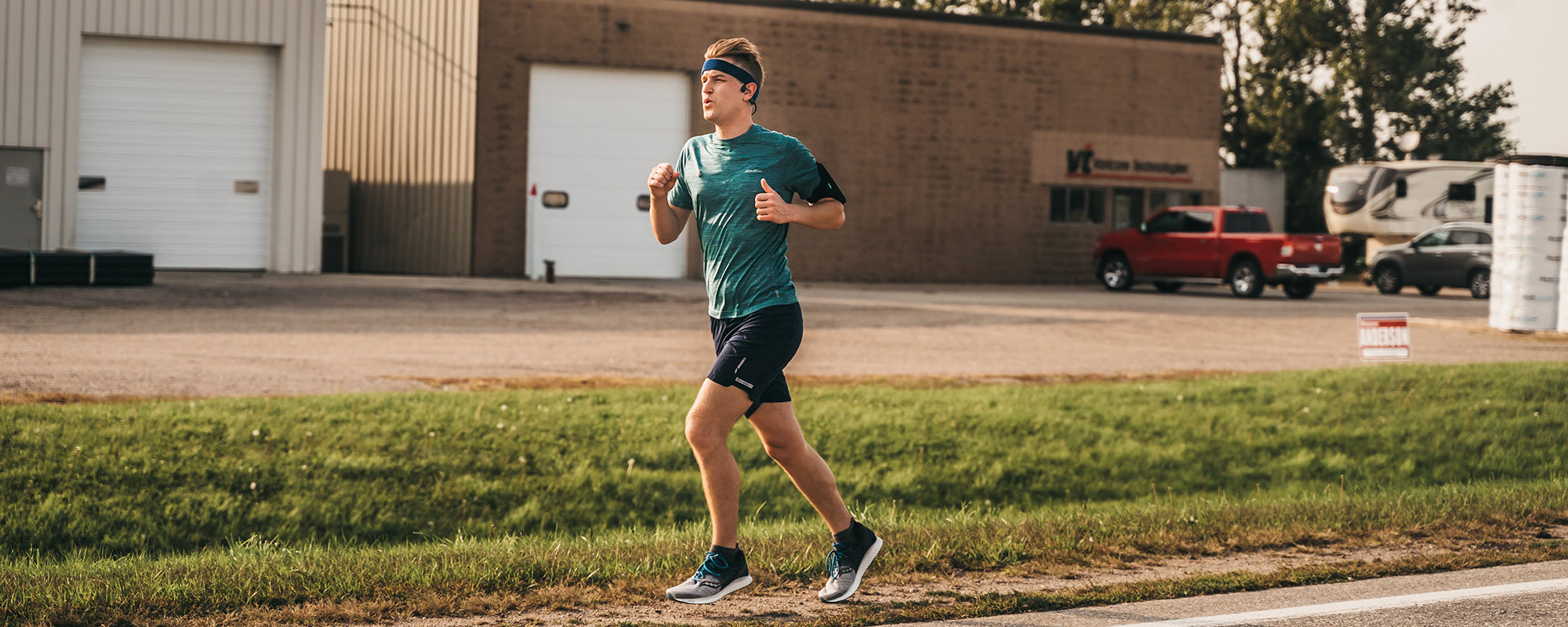 Outside Safe Space founder Mikah Meyer running across Minnesota wearing AfterShokz
