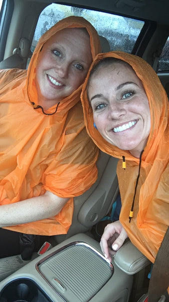 Kim and Caleigh in orange ponchos