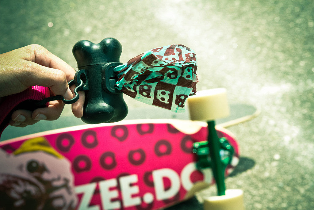 Bone shaped dispenser with Green/Brown poop bag inside | Zee.Dog