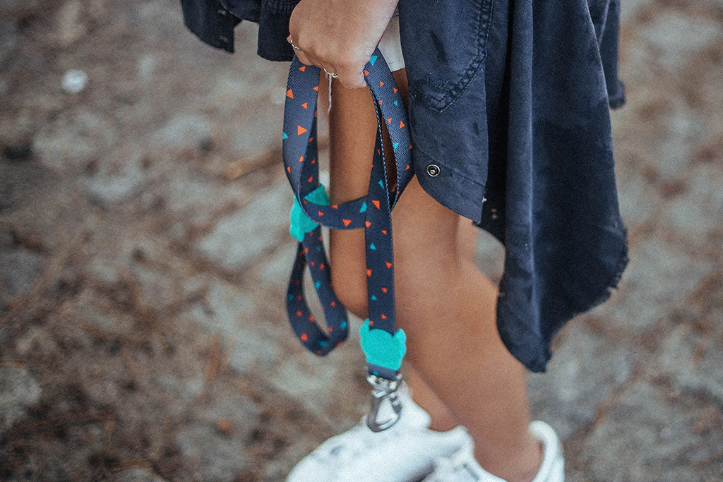 Girl holding a Triangles Dog Leash | Zee.Dog