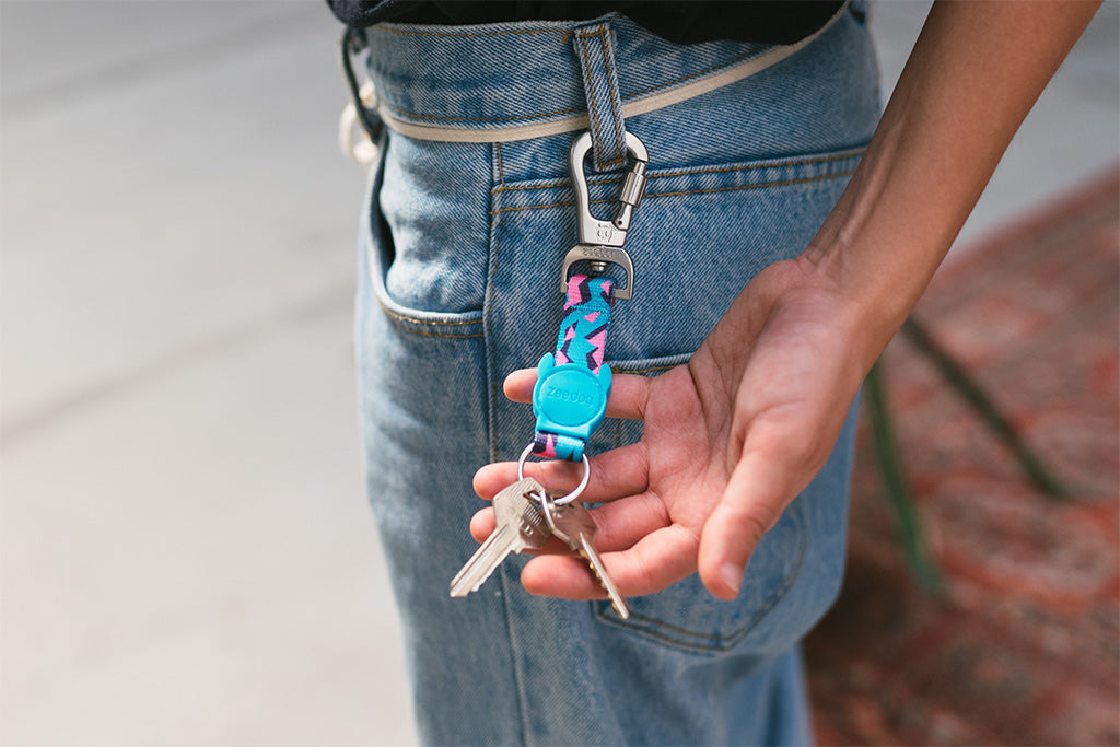 Girl holding a Crosby Keychain | Zee.Dog