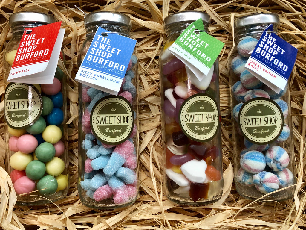 Glass Milk Bottles filled with various sweets