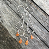 Sterling silver wire swirl earrings with carnelian drops