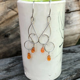 Sterling silver wire swirl earrings with faceted carnelian drops