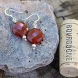 Faceted carnelian coin earrings with sterling beads and ear wires with cork for size reference