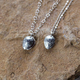 2 sterling silver leaf locket pendant necklaces with glass hearts inside. Sterling silver chain.