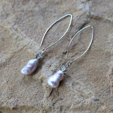 Elegant baroque pearl earrings on silver plated long oval ear wires with Swarovski crystals