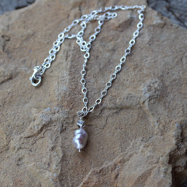 Baroque pearl pendant necklace on sterling silver chain with a gray Swarovski crystal