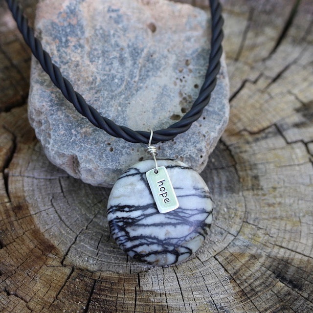 "Black silk agate stone pendant necklace with silver ""hope"" charm on twisted rubber cord"