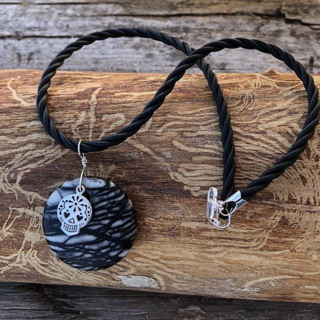 Black silk agate stone pendant necklace with silver sugar skull charm on a black twisted rubber cord