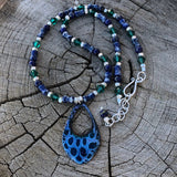 Blue enamel pendant necklace with lapis, green Swarovski crystals and sterling silver beads