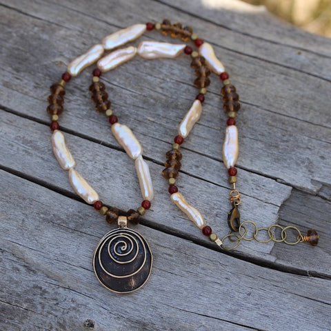 Bronze spiral pendant necklace with Biwa pearls, smoky quartz and carnelian