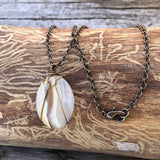 Bronze wire-wrapped agate stone pendant necklace on bronze chain.