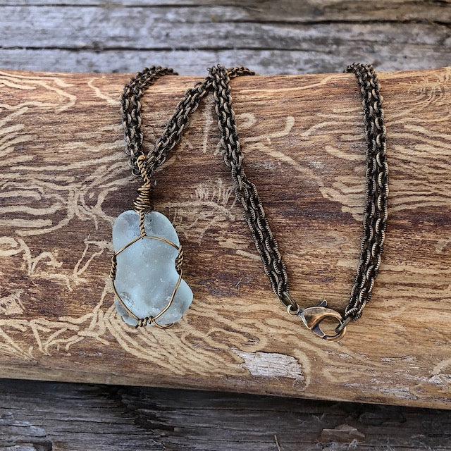 Bronze wire-wrapped sea glass pendant necklace on bronze double chain