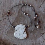 White calcite slab stone pendant necklace on hand knotted cord withSwarovski crystals and silver plated brass cube beads
