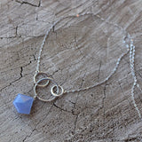 Blue chalcedony faceted pendant necklace with interlocking sterling silver rings