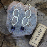 Hammered sterling link earrings with purple Swarovski cubes and cork for size reference