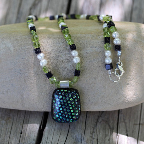 Dichroic glass pendant necklace with peridot, pearls and blue goldstone