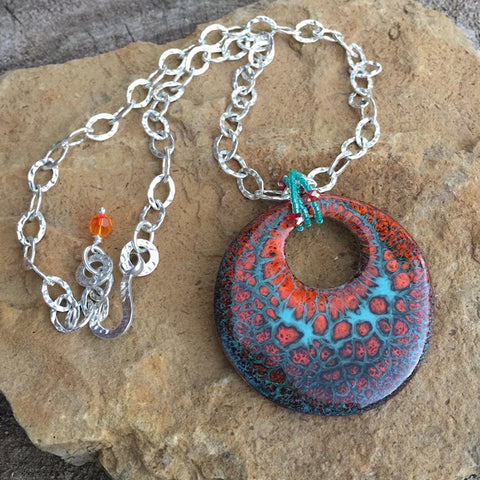 Enamel pendant in turquoise and orange on a hammered sterling chain necklace
