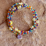 Equality charm stretch necklace or triple wrap bracelet with silver-lined rainbow beads and yellow Swarovski crystals
