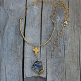 Gold rimmed druzy pendant necklace on gold filled chain with brass flower focal and brass branches