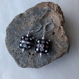 Earrings with handcrafted black and purple glass beads