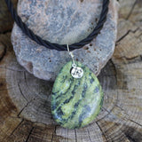 Green agate stone pendant necklace with silver compass charm on twisted rubber cord