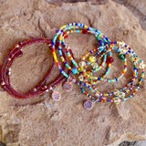 Equality charm stretch necklaces or triple wrap bracelets in red, rainbow, or silver lined rainbow beads