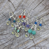 Group shot of bike charm earrings
