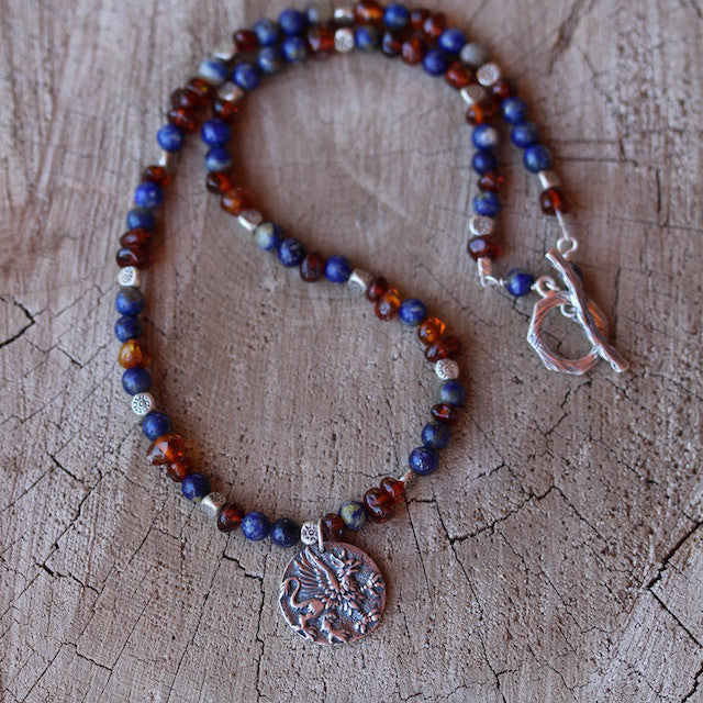 Sterling griffin pendant necklace with lapis and amber