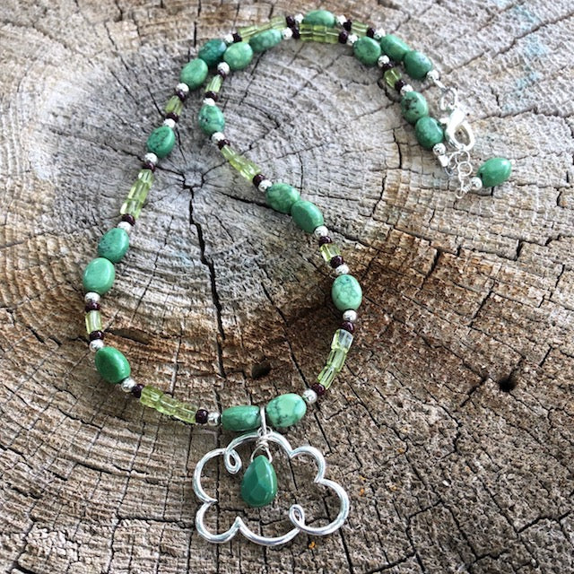 """Pray for rain"" cloud pendant necklace with turquoise and peridot"