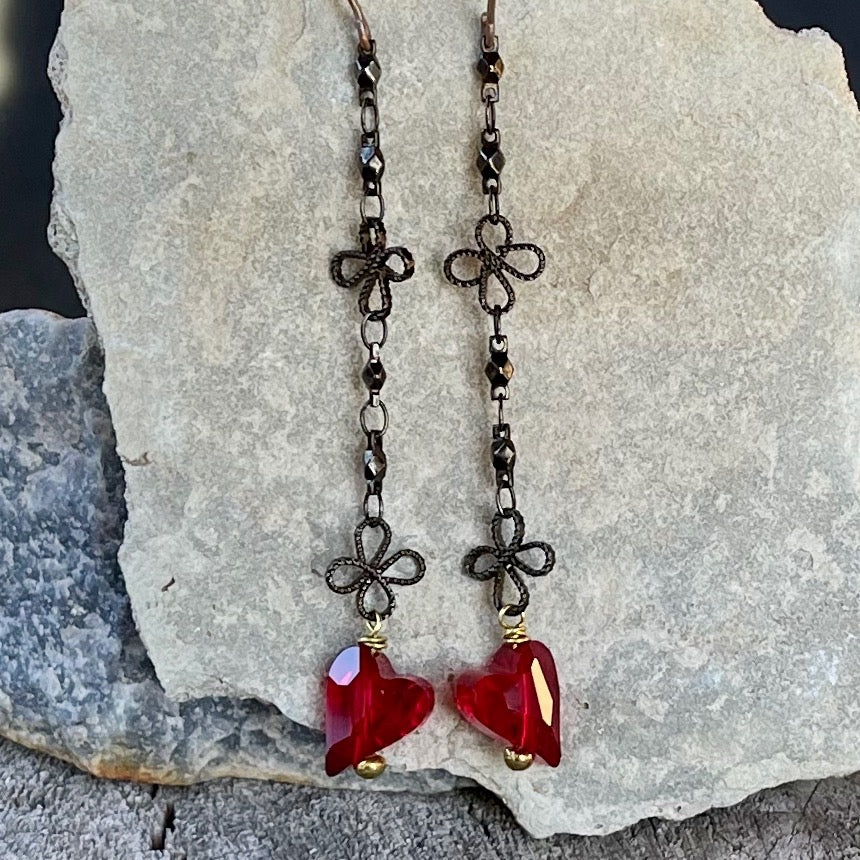 long dark bronze flower chain earrings with red Swarovski crystal hearts.