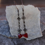 Long flower chain earrings with red Swarovski crystal hearts for a romantic touch.