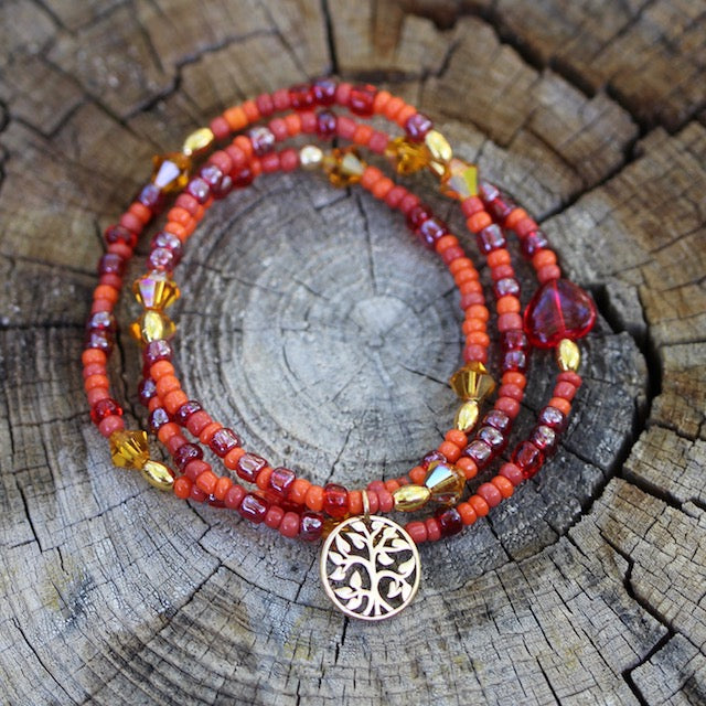 Orange beaded stretch necklace or triple wrap bracelet with Swarovski crystals and a bronze tree of life charm