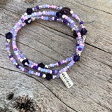 Stretch necklace or triple wrap bracelet with sterling believe charm and purple bead mix.