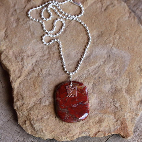 Red agate stone pendant necklace with sterling puppy charm