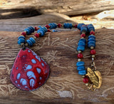 red and blue dappled enamel pendant necklace with blue shell and red coral beads.
