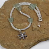 Snowflake pendant necklace with moonstone and recycled sea glass beads with sterling silver beads and clasp.