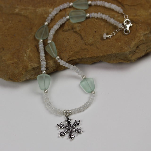 Snowflake pendant necklace with moonstone and pale aqua sea glass beads.