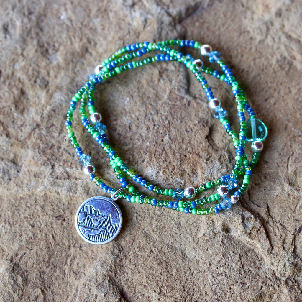 Stretch necklace or triple wrap bracelet with sterling mountains charm