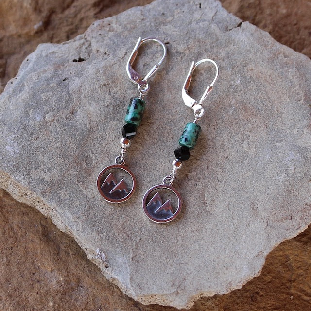 Earrings with sterling silver mountains charms and turquoise and black Swarovski crystals. Sterling silver lever back ear wires