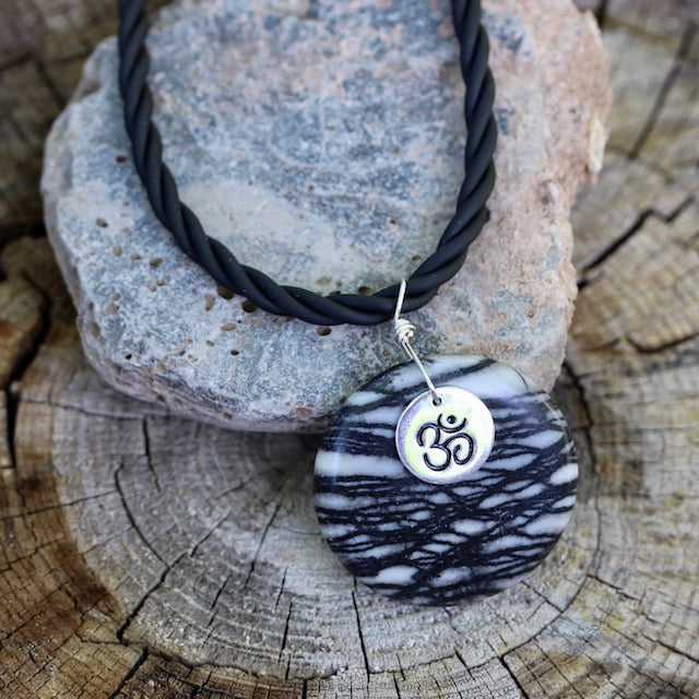 Black silk agate stone pendant necklace with sterling Om charm on rubber cord