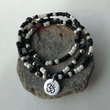 Stretch necklace or triple wrap bracelet with silver Om charm