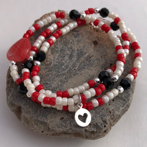 Red and white beaded stretch necklace or triple wrap bracelet with a silver heart charm and black Swarovski crystals