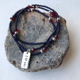 "Stretch necklace or triple wrap bracelet with navy blue seed beads, garnet red Swarovski crystals and  sterling charm that reads ""I heart you"""