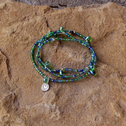 Stretch necklace or triple wrap bracelet with green and blue seed beads and a sterling tiny heart charm