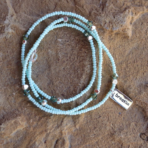 Stretch necklace or triple wrap bracelet with aqua seed beads and a sterling silver breathe charm